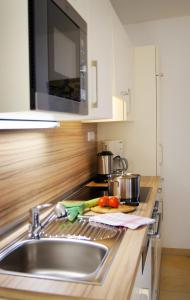 A kitchen or kitchenette at Simmernhof Mossendorf