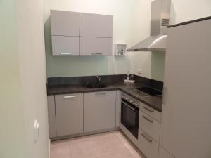 A kitchen or kitchenette at Gästezimmer & Appartement Elskop