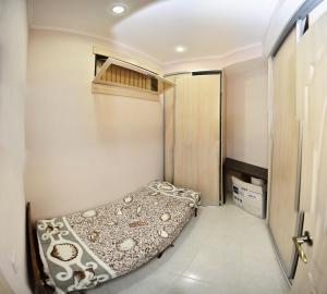 Кровать или кровати в номере квартира с 2мя спальнями в центре Сочи рядом с морем