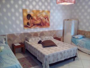 Cama ou camas em um quarto em Pousada Enseada do Sossego
