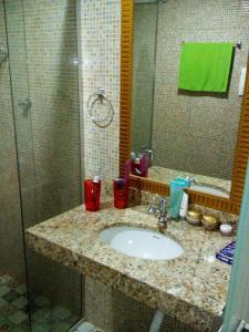 Um banheiro em Pousada Enseada do Sossego