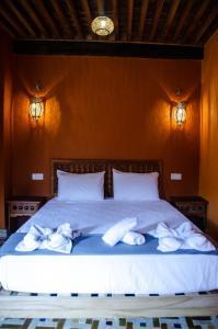 Cama o camas de una habitación en Medina social club