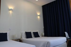 A bed or beds in a room at Enjoy Viana - Guest House