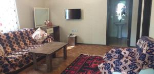 Uma área de estar em Korifey Hotel