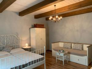A bed or beds in a room at Pension Amadeus & Apartments