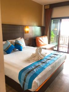 A bed or beds in a room at BB Mantra Boutique Hotel
