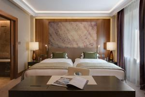 A bed or beds in a room at Grand Hotel Kempinski Riga