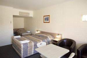 A bed or beds in a room at Pioneer Motel Goondiwindi