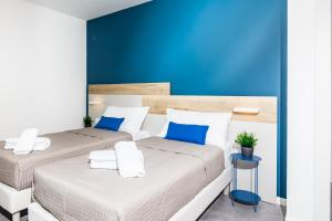 A bed or beds in a room at ADRIATICA aparthotel