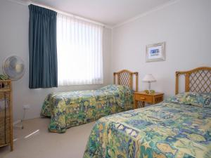 A bed or beds in a room at Castillo Del Mar 11 Overlooking Wallis Lake