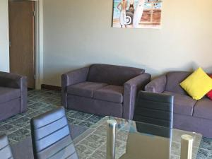 A seating area at Debra Court 6