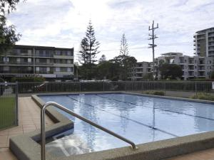 The swimming pool at or near Forster Holiday Lodge 19