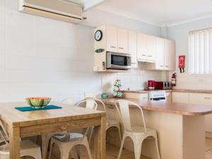 A kitchen or kitchenette at Forster Holiday Lodge 19