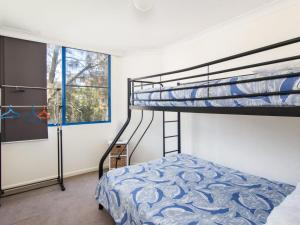 A bunk bed or bunk beds in a room at Heritage 202 Overlooking the Water