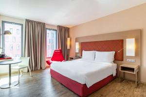 Un ou plusieurs lits dans un hébergement de l'établissement Radisson Blu Hotel Toulouse Airport