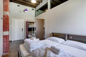 Un ou plusieurs lits dans un hébergement de l'établissement Generator Venice