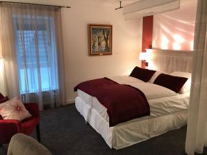 Ein Bett oder Betten in einem Zimmer der Unterkunft Hotel Altes Amtshaus