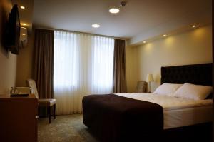 Lova arba lovos apgyvendinimo įstaigoje Pasažo namai B&B