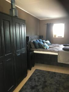 Säng eller sängar i ett rum på Kärrstegens Gård