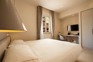 Letto o letti in una camera di Oriana Suites Verona