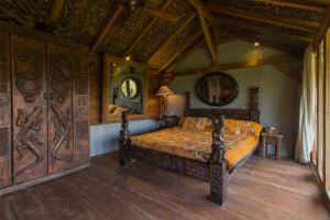 A bed or beds in a room at Rumah Lereng Bandung