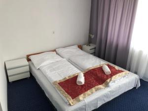 Łóżko lub łóżka w pokoju w obiekcie Złoty Łan