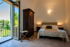A bed or beds in a room at Il Carmine Dimora Storica