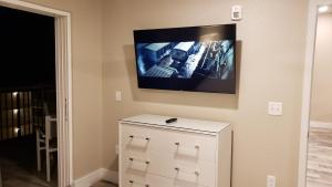 A television and/or entertainment centre at Barefoot Beach Club