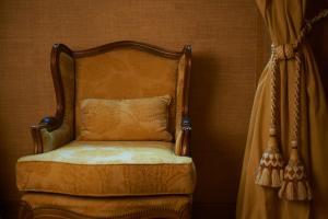 En eller flere senge i et værelse på Hotel Real Palacio