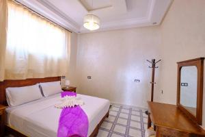 Un ou plusieurs lits dans un hébergement de l'établissement Hotel Central Palace