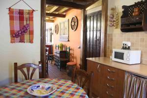 Una cocina o zona de cocina en La Casa del Abuelo Simón