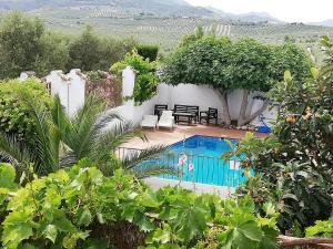 Vista de la piscina de Cortijo Los Abedules o alrededores