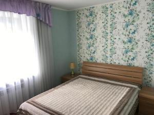 A bed or beds in a room at Элитная квартира