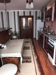 A kitchen or kitchenette at Элитная квартира