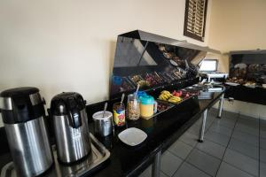 A kitchen or kitchenette at Hotel Campo Verde