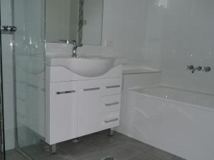 A bathroom at The Breakers 13