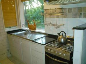 A kitchen or kitchenette at Rincon del Sur