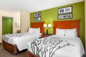 A bed or beds in a room at Sleep Inn Macon I-75
