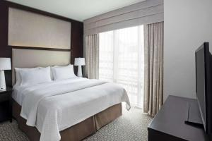 A bed or beds in a room at Cambria Hotel White Plains - Downtown
