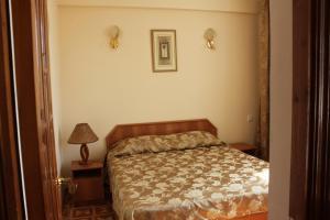 Кровать или кровати в номере Гостиница Лиана