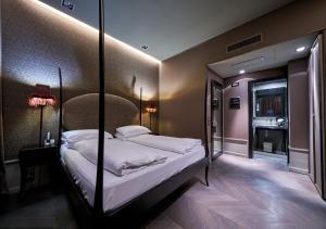 Cama ou camas em um quarto em Hotel Palazzo Barbarigo Sul Canal Grande