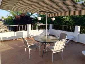 Un balcón o terraza de Cortijo Los Abedules