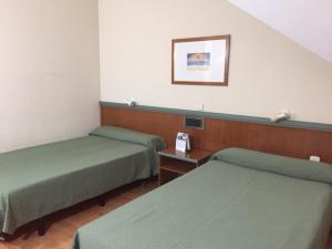 A bed or beds in a room at Miralcampo