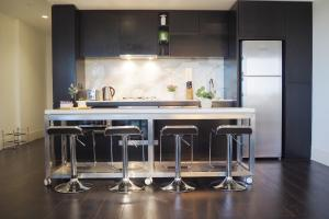 A kitchen or kitchenette at STYLISH 2BR 2BTH + CAR = HEART OF SOUTH YARRA
