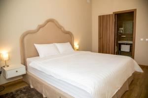 A bed or beds in a room at Parus Medical Resort & Spa