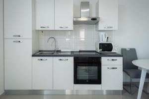 A kitchen or kitchenette at Panorama lux apartment