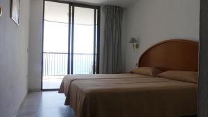 Cama o camas de una habitación en Apartamentos Oasis Benidorm
