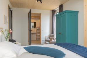 Een bed of bedden in een kamer bij De Groene Bollenschuur