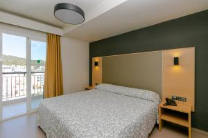 A bed or beds in a room at The Red Hotel - Adults Only