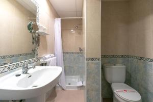 A bathroom at The Red Hotel - Adults Only